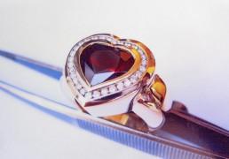 Geelgouden ring gezet met hart geslepen granaat edelsteen en briliant geslepen diamanten